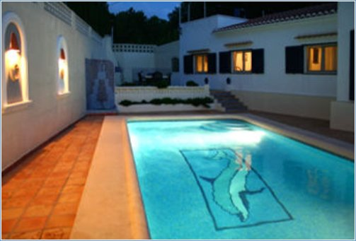 Pool By Night.Bedrooms lit to right