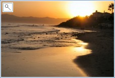 Sunset on beach at Las Chapas