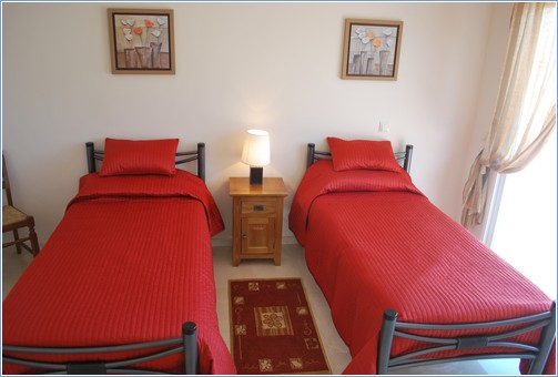 Two spacious modern twin bedrooms