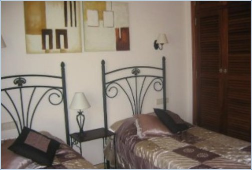 twin bedded room with built in ward