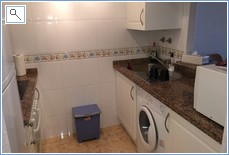 Kitchen area with oven, hob, microwave, kettle, toaster,