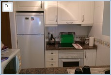 kitchen area, fridge freezer, washing machine
