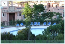 view to pool and sun beds around sunbathing area