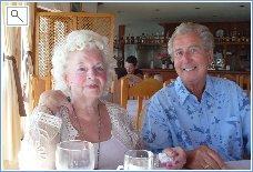 Happy guests at a beach bar