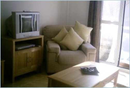 Comfortable lounge with TV and DVD player