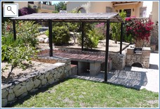 Barbeque and covered table