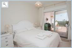 Master bedroom (en suite) with door leading to terrace