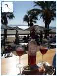 Enjoying wine and Tapas at a beach bar