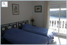Second bedroom with balcony overlooking bay of Cala Montgo