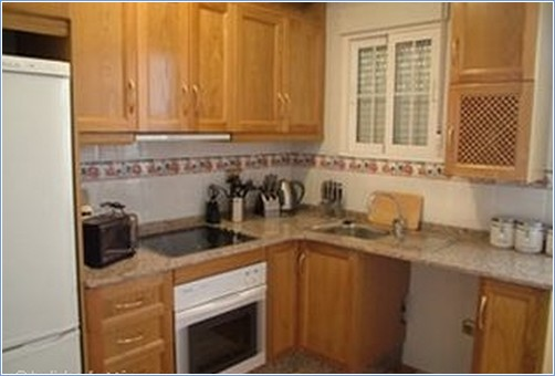 The spacious and well equipped kitchen.