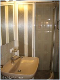 Bathroom with corner shower