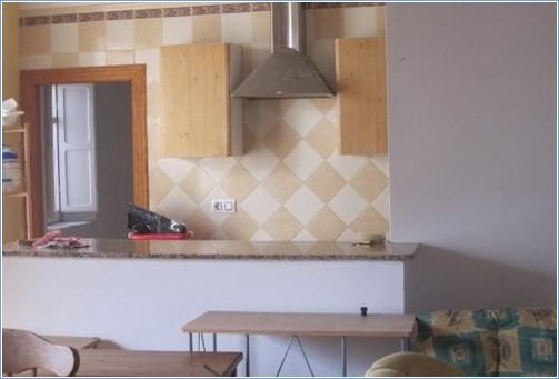 Kitchen area, doorway to 4th bedroom