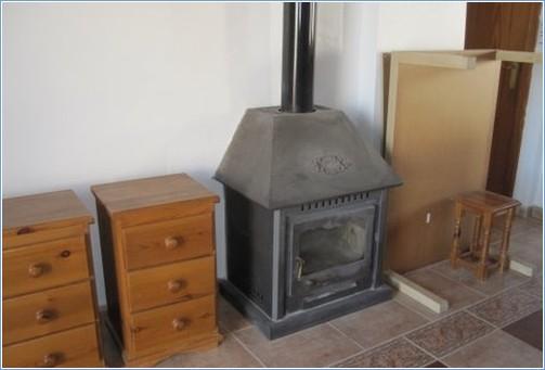 Wood burner in lounge, needs dusting!