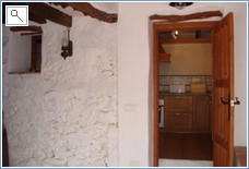 The entrance to the kitchen in the lower house.
