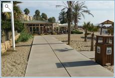 walking down the boardwalk from riviera to la cala