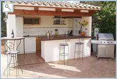 outside kitchen and bar with gas barbecue