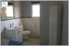En suite bathroom to larger twin bedroom