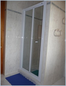 Family shower room with toilet & sink.