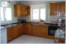 Kitchen with dishwaher, f/freezer, hob & oven.
