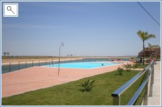 the swimming pool is 2mins from the apartment