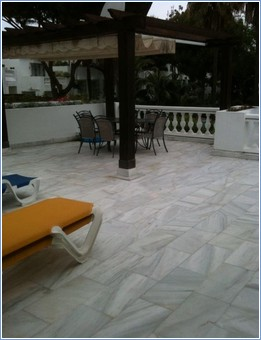 Large terrace with Pergola, sunbeds and dining area