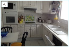 Kitchen area including all cooking utensils and delph
