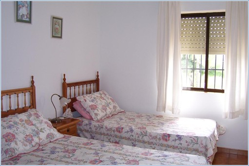 Front bedroom with two single beds