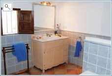 En suite bathroom with bath and shower