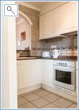 Fully equipped kitchen with American style arched opening to
