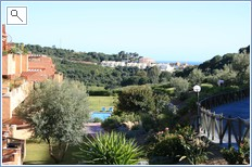 view of the apartment and gardens out to sea