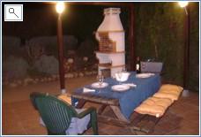 BBQ under gazebo at night