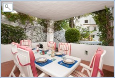 Our covered dinning terrace with small private garden