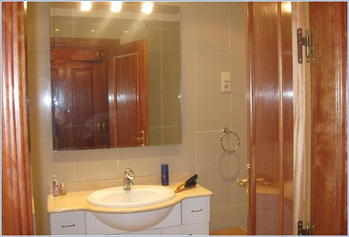 Ensuite   bathroom and shower  with vanity unit