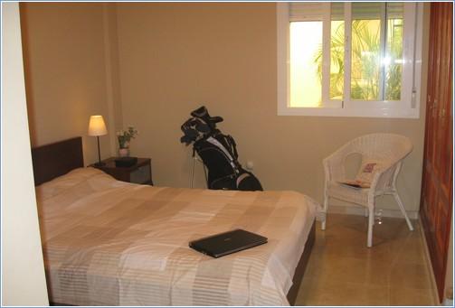 Second double bedroom overlooking interior garden area