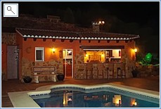 Bar, BBQ and outside kitchen by the swimming pool.At Night.