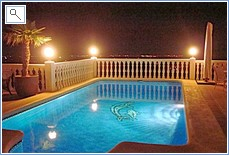 Swimming pool and terraces at night.