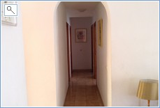 Hallway leading to bathrooms and bedrooms