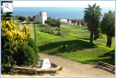 view from the top of golf course looking down towards sea