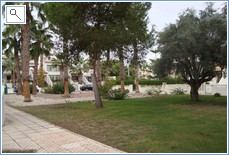Gardens in front of apartment.